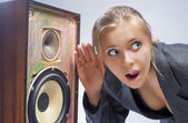 Surprised Caucasian Blond Female Harkens to Outdated Loudspeaker — Stock Photo