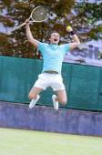 Tennis Sport Concept: Portrait of young Exclaiming Male Caucasia — Stock Photo