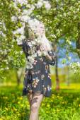 Relaxing Caucasian Blond Woman With Long Hair in Park Near Bloom — Stock Photo