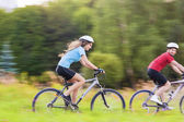 Bicycle and Sport Concepts. Young Caucasian Couple Cycling — Stock Photo