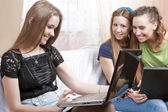 Portrait of Three Young Caucasian Girlfriends With Laptops Looki — Stock Photo