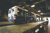 Dirty, oily bus garage inspection pit — Stock Photo