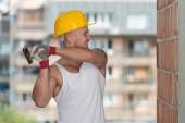 Builder Working With Hammer And Nail — Stock Photo