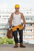 Construction Worker Carrying Brick — Foto de Stock