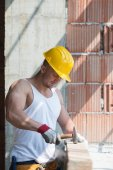 Construction Man Hitting Wood With Hammer — Stock Photo