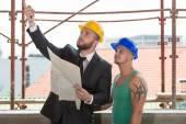 Businessman Showing Industrial Worker At Construction — Stock Photo