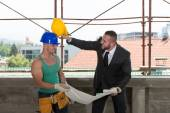 Businessman And Industrial Worker Playing Around — Stock Photo