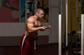 Bodybuilder Exercising Triceps — Stock Photo