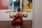 Young Male Doing Back Exercises In The Gym — Stock Photo