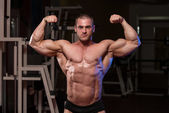 Muscular Man Is Hitting Rear Double Bicep Pose — Stock Photo
