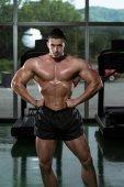 Muscular Man Flexing Muscles — Photo
