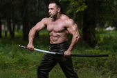 Mature Man In Action With Sword — Stock Photo