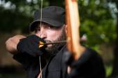 Archer Holds His Bow Aiming At A Target — Stock Photo