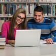 Couple Of Students With Laptop In Library — Stock Photo #58468397