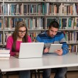 Happy Students Working With Laptop In Library — Stock Photo #58468621