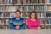 Couple Of Students In A Library — Stock fotografie