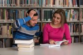 Young Students Working Together In The Library — Stock fotografie