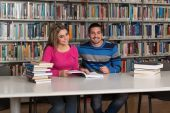 Two College Students In Library Reading Books — Stock fotografie