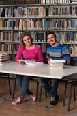 Two College Students In Library Reading Books — Stock Photo