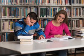 Portrait Of A Student Couple In A Library — Stock Photo