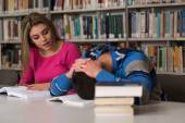 Male Student Sleeping In Library — Stock fotografie