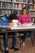 Male Student Sleeping In Library — Stock Photo