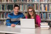 Young Students Using Their Laptop In A Library — Stock Photo