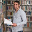 Handsome Young College Student In A Library — Stock Photo #58470915