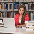 Happy Female Student With Laptop In Library — Stock Photo #58472357