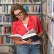 Pretty Young College Student In A Library — Stock Photo #58473357