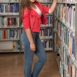 Pretty Young College Student In A Library — Stock Photo #58473861