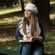 Beautiful Young Girl Reading A Book In Park — Stock Photo #58475211