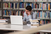 Confused Male Student Reading Many Books For Exam — Stock Photo