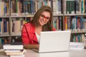 Young Student Using Her Laptop In A Library — Foto de Stock