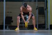Young Man Doing Back Exercises In The Gym — Stock Photo