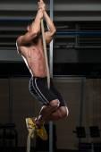 Fitness Athlete Climbing A Rope — Stockfoto