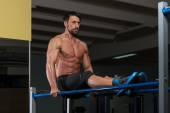 Fit Athlete Doing Exercise On Parallel Bars — Stock Photo