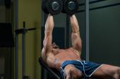 Male Athlete Doing Heavy Weight Exercise For Chest — Stock Photo