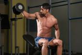 Bodybuilder Exercising Shoulders With Dumbbells — Stock Photo