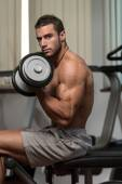 Healthy Young Man Doing Exercise For Biceps — Stock Photo