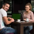 Happy Group Of Teenagers At Cafe Using Laptop — Stock Photo #60879445