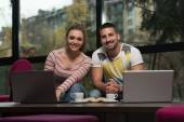 Happy Teenagers Using Laptop In Cafe — Stock Photo