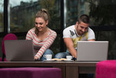 Smiling Young Students In Cafe Using Laptop — Stock Photo