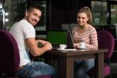 Happy Group Of Teenagers At Cafe Using Laptop — Stock Photo