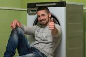 Young Man Doing Housework Laundry Thumbs Up Sign — Stock Photo