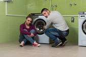 Young Couples Doing Housework Laundry — Stock Photo