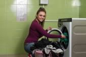 Young Woman Putting A Cloth Into Washing Machine — Stock Photo