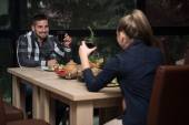 Couple Having Dinner In A Restaurant — Stock Photo