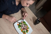Young Beautiful Woman Having Dinner In A Restaurant — Stock Photo