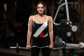 Woman Doing Heavy Weight Exercise For Trapezius — Stock Photo